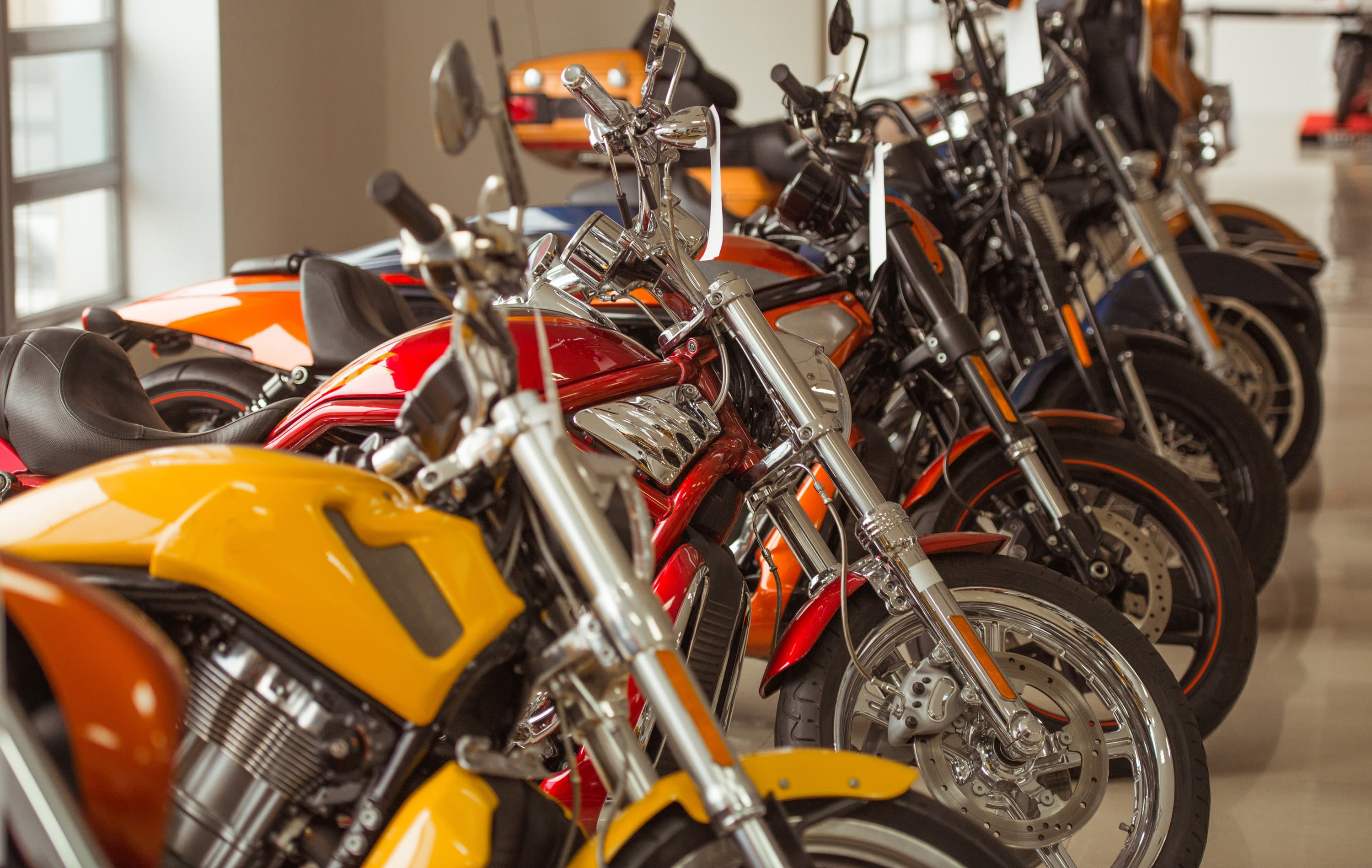 Several motorcycles lined up - Used Harleys