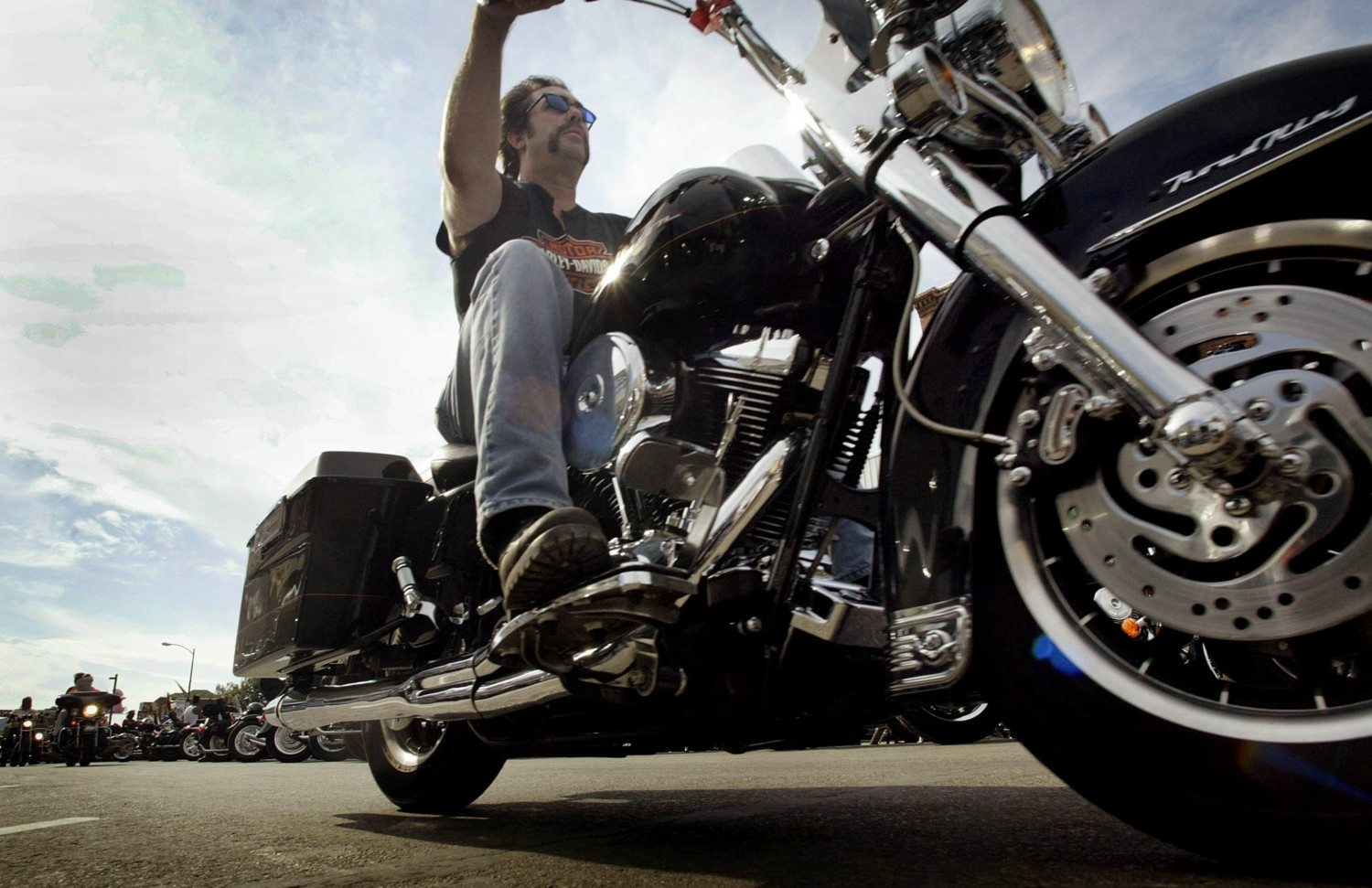Man riding a Harley-Davidson motorcycle