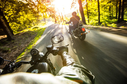 Two people riding motorcycles - Used Harleys