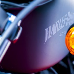 """a black harley davidson """"sportster iron xl 883"""" is parked on a road near cochin city in Kerala during a marathon event - Used Harleys"""